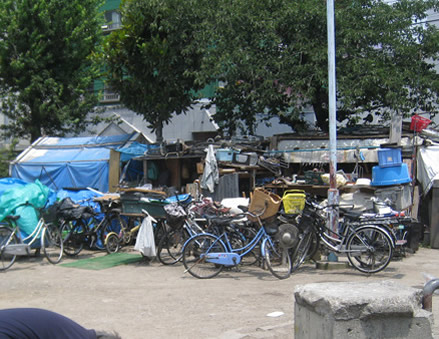 Tents of homeless in Triangle Park in Kamagaseki in Nishinari Ku Osaka Japan